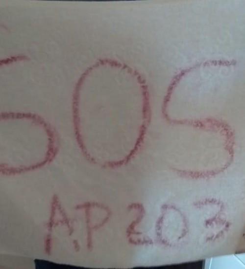 Mulher pede socorro com mensagem em toalha, após ser ameaçada em Chapecó - SC.